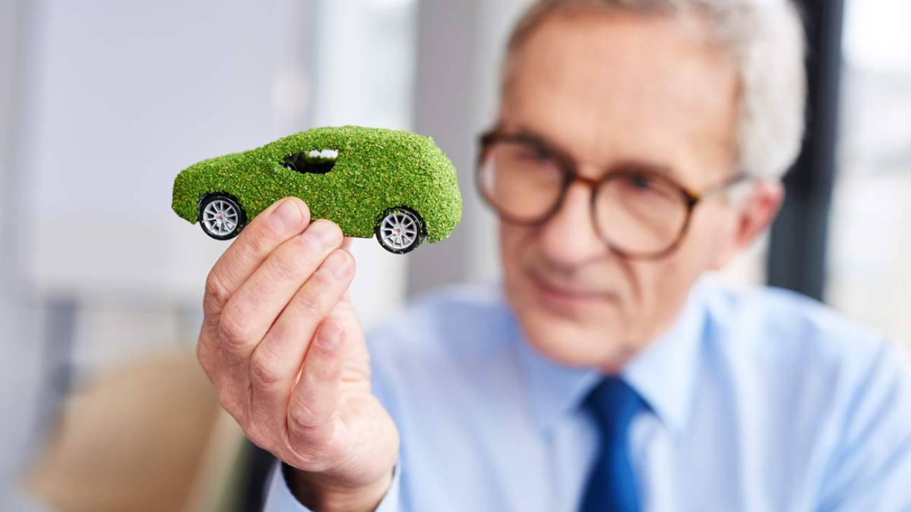Business owner holds environmentally friendly toy car