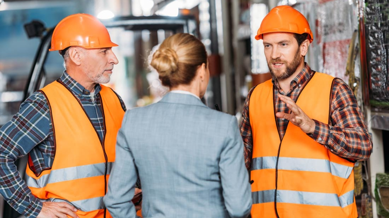 Health and safety workers chat with management