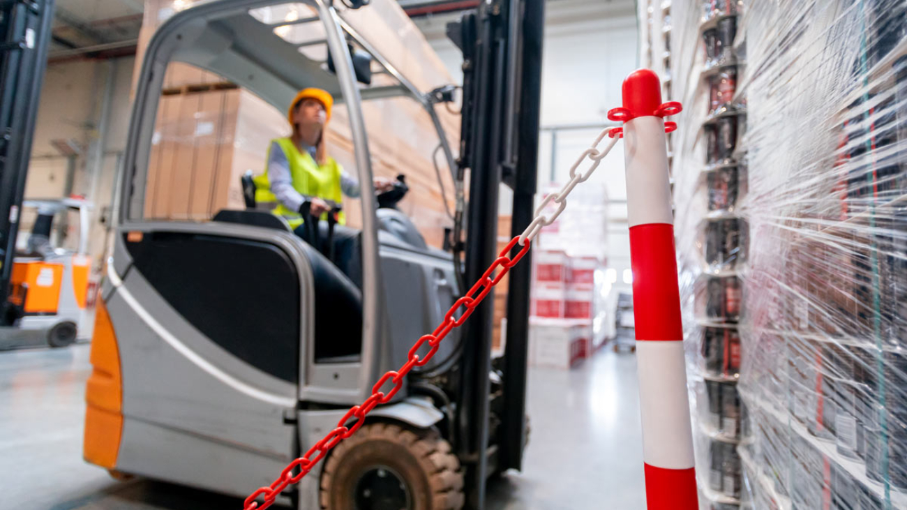 Worker uses forklift